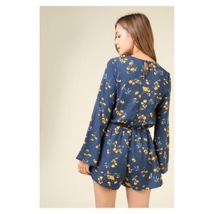 Urban Outfitters Pants - Blue Yellow Floral Surplice Neckline Romper